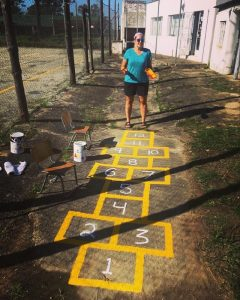Barclee painting the playground at YWAM St. Lucia